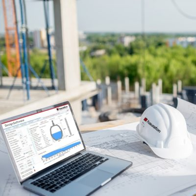 Hydraulic Calculation Software on laptop on a construction site view